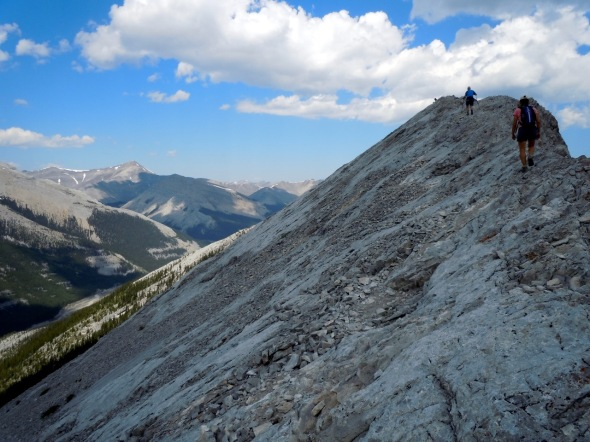 Middle-aged scramblers on Nihahi Ridge, Kananaskis Country, Alberta, Canada. Photo by Rodney Steadman